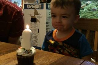 This Cute 2-Year-Old Boy Tries To Blow Out His Birthday Candle & Constantly Fails
