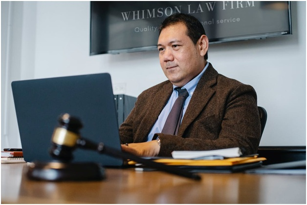 A lawyer using a laptop